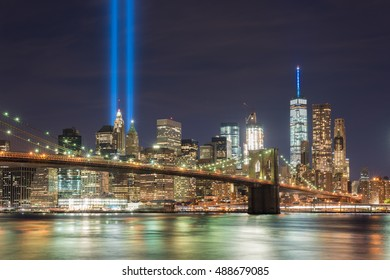 New York City Manhattan downtown skyline at night with the Tribute in Light in memory of September 11.
