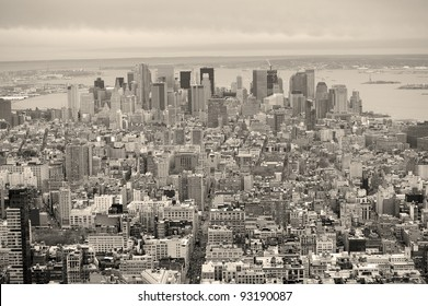 New York City Manhattan downtown aerial view with urban city skyline and skyscrapers buildings in black and white.