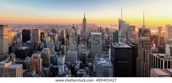 New York City. Manhattan downtown skyline skyscrapers at sunset.