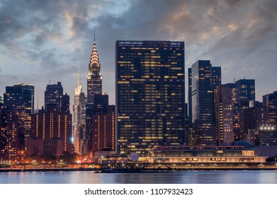 New York City, Manhattan famous landmark buildings skyline at beautiful colorful sunset, United Nations Headquarters