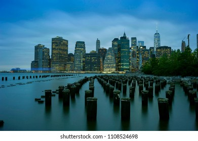 New York City Manhattan Financial District panorama at dusk with skyscrapers illuminated over East river