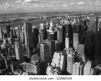 New York City Manhattan midtown aerial panorama view with skyscrapers and blue sky in a autumn day.