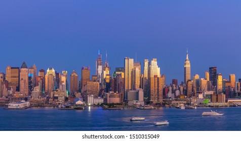 New York City Manhattan midtown buildings skyline at evening sunset