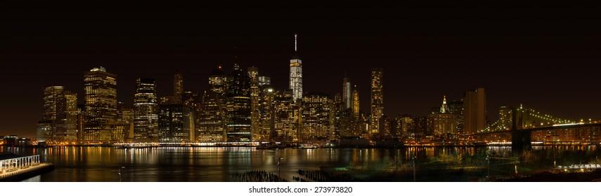 New York City Manhattan night panorama with Brooklyn bridge