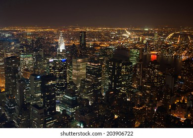 New York City Manhattan  panorama aerial view at night with office building skyscrapers skyline