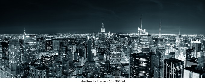 New York City Manhattan skyline at night panorama black and white with urban skyscrapers.