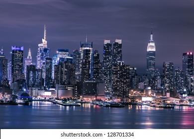 New York City Manhattan skyline panorama at night over Hudson River