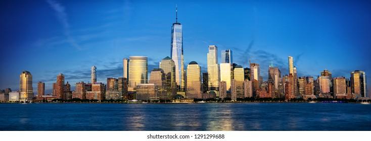 New York City Manhattan skyline panorama with urban skyscrapers at dusk
