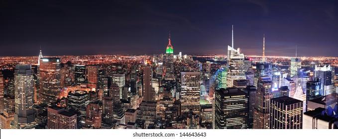 New York City Manhattan skyline at night panorama with urban skyscrapers.