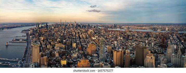 New York City Manhattan skyline panoramic aerial view with Hudson River at sunset.