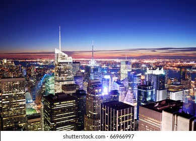 New York City Manhattan skyline with Times Square aerial view at night.
