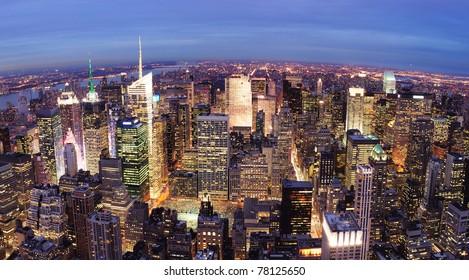 New York City Manhattan city skyline aerial view with urban skyscraper illuminated.