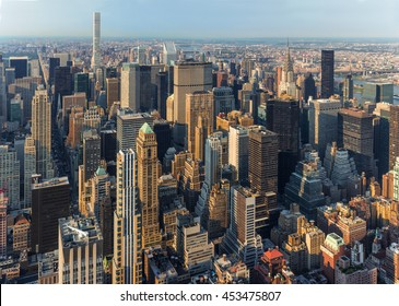 New York City Manhattan street aerial view with skyscrapers. Skyscrapers New York. Skyscrapers aerial. Skyscrapers in New York at sunset.
