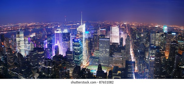 New York City Manhattan Times Square skyline aerial view panorama at night with skyscrapers and street.
