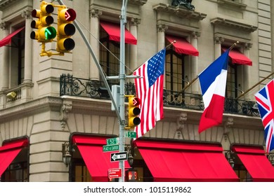 New York City, Manhattan, U.S.: January 27, 2018: New York city street signs on trafic signs with American flag