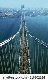NEW YORK CITY MARATHON - NOVEMBER 1995: Marathon runners pass over the Verrazano-Narrows Bridge as seen from the top of one of the bridges towers.