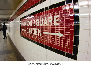 NEW YORK CITY - MARCH 1, 2015:  Sign to landmark Madison Square Garden in NYC seen on subway platform at Penn Station.