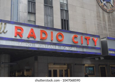 NEW YORK CITY - March 11, 2018 - Radio City Music Hall Venue, Beautiful Theatre In Downtown Manhattan, Neon Lights Outside, NYC Streets, Tourism Destination, Musicals And Concerts, Americas Got Talent