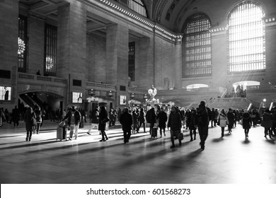 New York City, New York  March 13, 2017: Rays of sunlight inside of Grand Central Station with people walking in the rush time