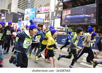 NEW YORK CITY - MARCH 15 2015: the New York Road Runners held their first ever Times Square Kids' Run a 1500 meter run coinciding with the NYRR annual Half Marathon on Seventh Avenue