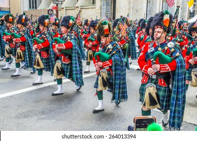 NEW YORK CITY - MARCH 17: Irish bagpipers march at St. Patrick's day on March 17, 2015, the annual St. Patrick's Day Parade along Fifth Avenue in Middle Town of Manhattan, New York.