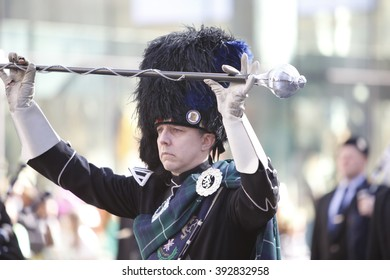 NEW YORK CITY - MARCH 17 2016: Thousands lined 5th Ave to witness Mayor de Blasio's first march in the nation's oldest & largest St Patrick's Day parade. Drum major in bearskin cap with baton