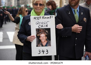 NEW YORK CITY - MARCH 17 2016: Thousands lined 5th Ave to witness Mayor de Blasio march for the first time in the nation's largest St Patrick's Day parade. Memorial to 911 responders group