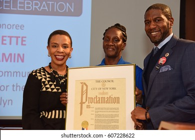 NEW YORK CITY - MARCH 17 2017: NY City Council Members Jumaane Williams & Laurie Cumbo presided over Shirley Chisholm Women of Distinction Awards. Ronette Benjamin with Laurie Cumbo & Jumaane Williams