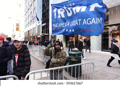 NEW YORK CITY - MARCH 2 2017: Hundreds rallied in front of the NYPL Main Branch to protest continuation of the Keystone Pipeline & march to Trump Tower.Trump supporters rally along 5th Avenue