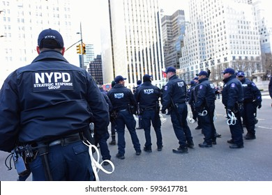 NEW YORK CITY - MARCH 2 2017: Hundreds rallied in front of the NYPL Main Branch to protest continuation of the Keystone Pipeline & march to Trump Tower. NYPD Strategic Response Group w/ plastic cuffs