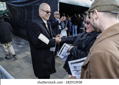 NEW YORK CITY - MARCH 20 2014: HBO's Game of Thrones series provides Brooklyn residents with a premiere of season four at the Barclay's Center. Staff attach wristbands to fan already cleared for entry