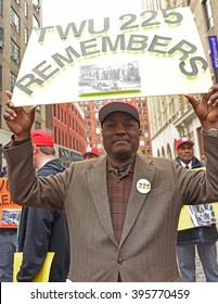 NEW YORK CITY - MARCH 23 2016:  Labor, political & religious leaders  gathered to commemorate the anniversary of the Triangle Shirtwaist fire. Transport Worker 225 member with sign