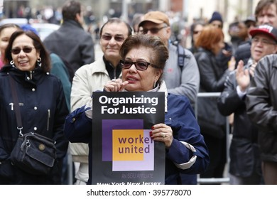 NEW YORK CITY - MARCH 23 2016:  Labor, political & religious leaders  gathered to commemorate the 105th anniversary of the Triangle Shirtwaist fire. Woman with Organizing for Justice sign