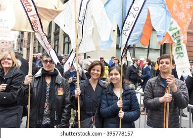 NEW YORK CITY - MARCH 23 2016:  Labor, political & religious leaders  gathered to commemorate the 105th anniversary of the Triangle Shirtwaist fire. Attendees with symbolic shirtwaists on poles