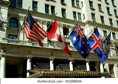 New York City - March 23, 2005:  American, Canadian, Australian, and British flags fly above the marquee of the venerable Plaza Hotel on Fifth Avenue