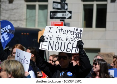 New York City - March 24, 2018: People holding signs at the March for Our Lives against gun violence in New York City.