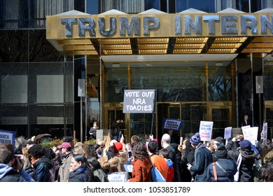 New York City - March 24, 2018: People holding signs in front of the Trump International Hotel at the March for Our Lives against gun violence in New York City.