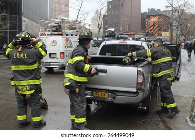 NEW YORK CITY - MARCH 26 2015: an explosion & fire on East 7th St in Manhattan's East Village destroyed three brownstones, left 14 people injured & two people missing. FDNY arrives on scene