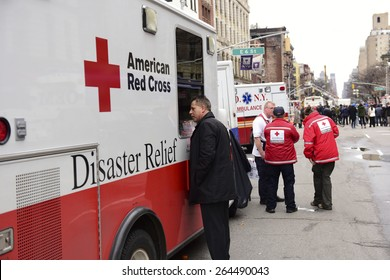 NEW YORK CITY - MARCH 27 2015: one day after a fire & explosion in Manhattan's East Village, 2 people remain missing as workers clear the wreckage of three destroyed brownstones.American Red Cross van