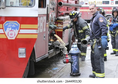 NEW YORK CITY - MARCH 27 2015: one day after a fire & explosion in Manhattan's East Village, two people remain missing while emergency personnel clear the wreckage of three destroyed brownstones