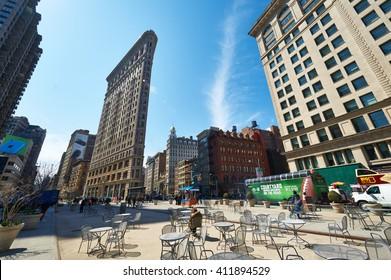 NEW YORK CITY - MARCH 27: Historic Flatiron Building at Manhattan street,  March 27 2014 in New York, USA