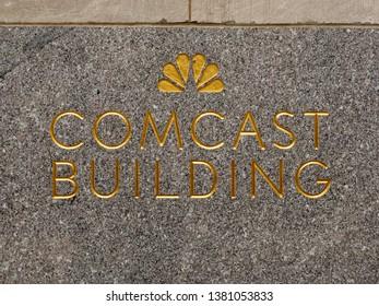 New York City - March 29, 2019: Sign for Rockefeller Center/Comcast Building in Midtown Manhattan, New York City.