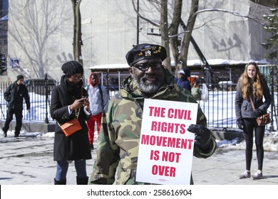 NEW YORK CITY - MARCH 7 2015: Brooklyn borough president Eric Adams led several hundred marchers across the Brooklyn Bridge to borough hall in commemoration of the 50th anniversary of Bloody Sunday