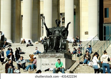 New York City - March 7, 2006:  Students sitting on the Columbia University Library steps next to the famed Alma Mater sculpture