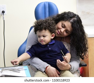 NEW YORK CITY - MAY 1 2018: Park Slope's principle audiology practice brings both adult & pediatric patients in for exams and treatment. Child with parents prepares for pediatric check up