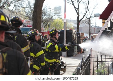 NEW YORK CITY - MAY 1 2014: Several FDNY engine & ladder companies respond to a house fire in the Gowanus neighborhood of Brooklyn.