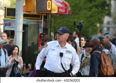 NEW YORK CITY - MAY 1 2017: Marches & rallies in support of labor, healthcare & immigrants throughout Lower Manhattan. Deputy NYPD Inspector Lombardo