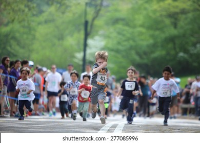 NEW YORK CITY - MAY 10 2015: New York Road Runners sponsored a Kids' Run in Central Park to mark the 9th annual Japan Day. Kids 2 - 12 participated in groups staggered by age & sex