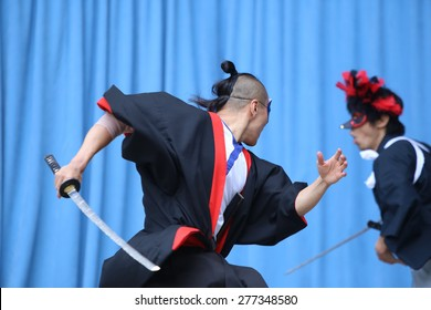 NEW YORK CITY - MAY 10 2015: the ninth annual Japan Day was celebrated in Central Park with demonstrations of folk-dance, swordsmanship, calligraphy, kabuki face painting & Japanese foods.