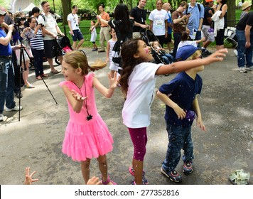 NEW YORK CITY - MAY 10 2015: the ninth annual Japan Day was observed in Central Park with demonstrations of swordsmanship, kabuki face painting, folk dances, Japanese foods, costumes & music